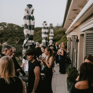 Guests mingle outside at a Dunbar House Sydney event