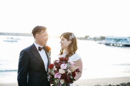 Couple poses for beach wedding photos at Dunbar House Sydney
