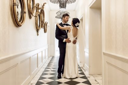 Couple posing for wedding photos on the chequered hallway at Dunbar House Sydney