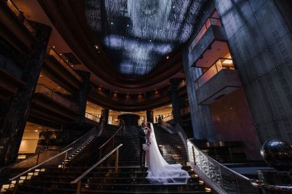 Bride and Groom on the Foyer Steps at Crown Melbourne, Luxury Weddings and Events Venue