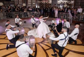 Bride and groom on dancefloor with drummers at Park Hyatt Melbourne wedding ballroom