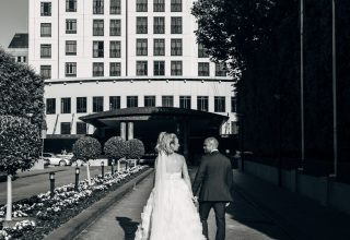 Wedding couple walking in front of Park Hyatt Melbourne Photo by Love and Other Photography