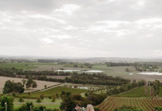 Yarra Valley winery wedding ceremony at Levantine Hill photo by Erin & Tara couple in vineyards