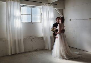 Gather & Tailor -Wedding-couple-window-kiss-Gather-Tailor-Melbourne-Photo-by-Art-of-Grace.jpg